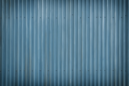 Cool Blue corrugated Metal and bolts with light vignette Imagens - 24526163