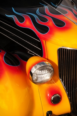 fire car: Chrome and flame details on a vintage Hot Rod.
