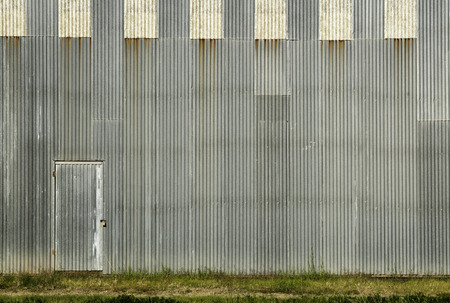 Door and the corrugated wall ready for your art work Imagens - 26085614
