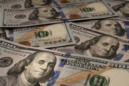 One Hundred Dollar bills with Benjamin Franklin highlighted