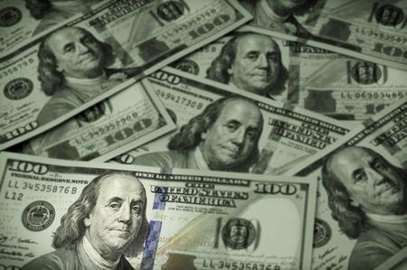 Ben Franklin focus among a background of United States hundred dollar bills