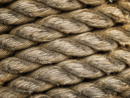 Old weathered rope worn down to expose individual strands