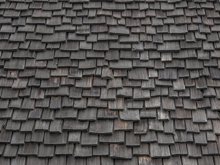 Old weathered wooden shingles continue being used as roofing material. Imagens - 29844406