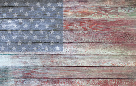 Vintage old American flag paint on the sideof a barn Imagens