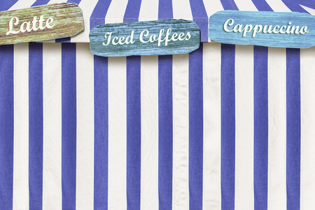 Iced Coffees, Cappuccino, Latte advertised on a circus style tent Imagens - 31821346