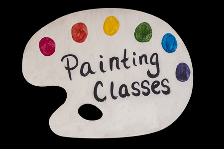 advertised: Art painting classes advertised on a colorful artist palette Stock Photo