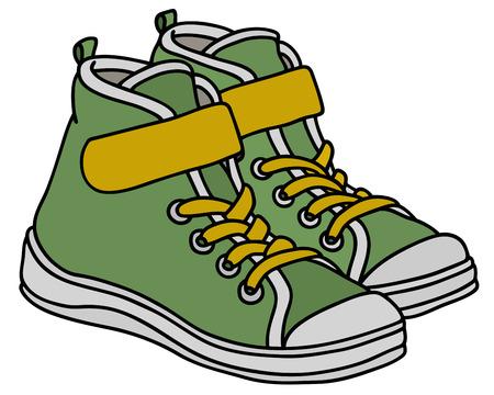 Groene en gele kinderen sportschoenen