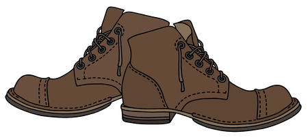 Old brown leather lacing boots.