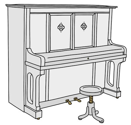 The white closed piano with a chair