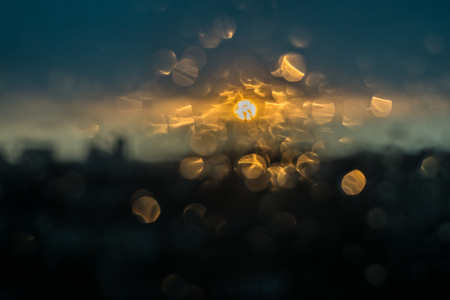 Unfocuced sun and water drops on the window Stock Photo - 73530566