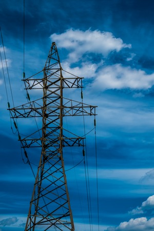 metal grid: High voltage power line tower with blue sky on backgound