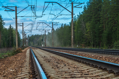 famous industries: Railroad track winding through forest Stock Photo