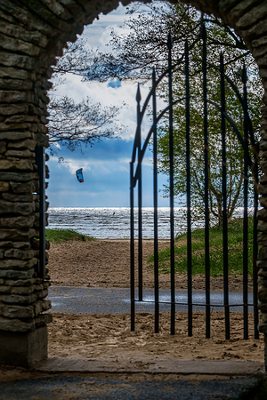 Gates to the beach with a kite surfer on background Stock Photo