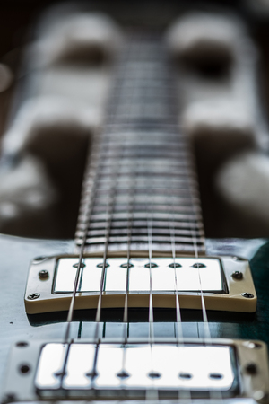 Electric guitar pickups and neck close up view unocused
