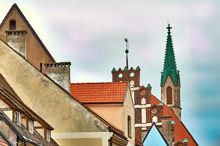 Red roofs of old houses in Skarnu iela street with St Johns church in the background Riga Latvia