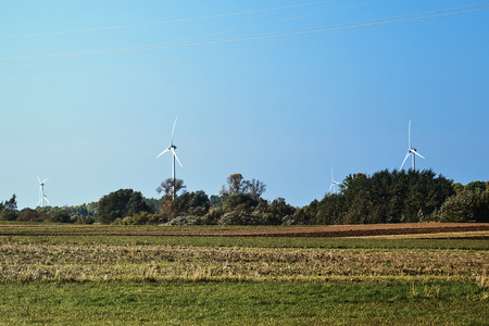 Green meadow and Wind turbines generating electricity Stock Photo