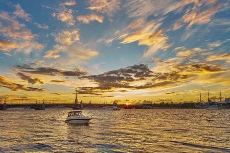 Beautiful sunset on Neva river with Troitsky bridge and Peter and Paul. Saint Petersburg, Russia.