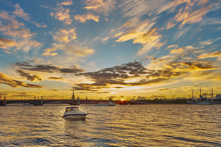 Beautiful sunset on Neva river with Troitsky bridge and Peter and Paul. Saint Petersburg, Russia.