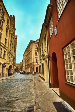 Old medieval morning narrow street in Riga, Latvia. Retro styled. Stock Photo