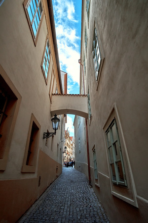 Narrow cobblestone street in the old center of Prague - the capital and largest city of the Czech Republic - travel background. 版權商用圖片