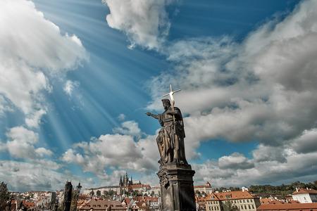 Statue of John the Baptist on the Charles Bridge with Prague Castle.