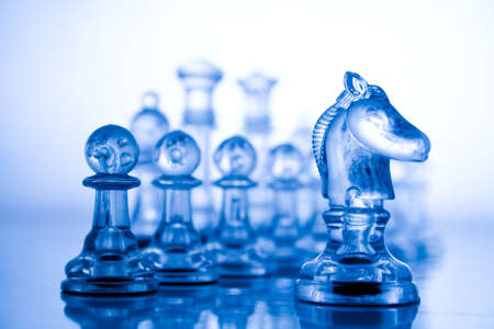 conquering: Blue transparent chess Stock Photo