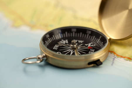 Gold compass & map photo