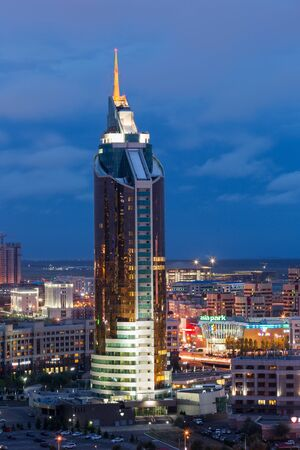 ASTANA, KAZAKHSTAN - August 25, 2015: View of the Tower skyscraper building - Ministry of Transport and Communications. Modern architecture. Cityscape Редакционное