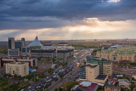 ASTANA, KAZAKHSTAN - August 25, 2015: Evening view from the top on shopping center Khan Shatyr, Jumbaktas hotel and Kabanbay Batyr Avenue. Редакционное