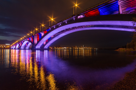 Reflection of the Communal Bridge in the Yenisei river, Krasnoyarsk, Russia. Urban landscape