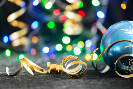 Party Background with Christmas toy, lights and serpentine Фото со стока