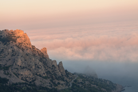 Mountain Cat in the sunset and heavy fog. The Town Of Simeiz. The Peninsula Of Crimea. Black Sea