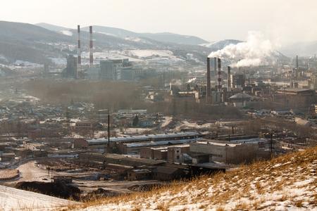 Smoking industrial pipes of the Krasnoyarsk. Black sky mode. Concept of dirty ecology Фото со стока