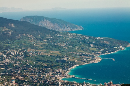 View of the Black Sea from Mount Ai-Petri. Below the village of Alupka Big Yalta. Sunny weather
