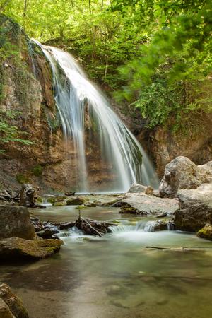 Beautiful waterfall Jur-Jur in the Crimea, spring landscape