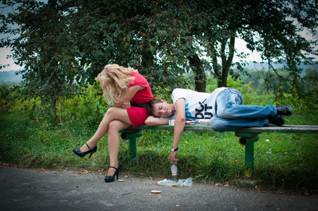 abusive man: drunk guy and girl crushed Stock Photo