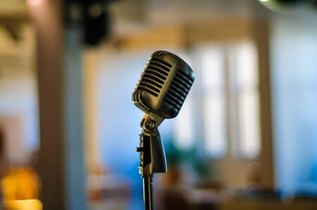 Vintage microphone on a stand in an empty coffee shop, vintage decoration in the light, Beautiful