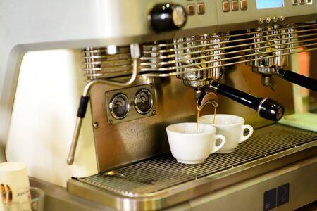 prepares espresso in his coffee shop close-up