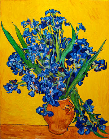 Oil painting on canvas. Vase with irises on a yellow background. Free copy based the famous painting by Vincent Van Gogh. Banco de Imagens