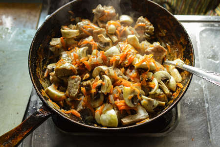 Roasted meat with vegetables on a pan. Food