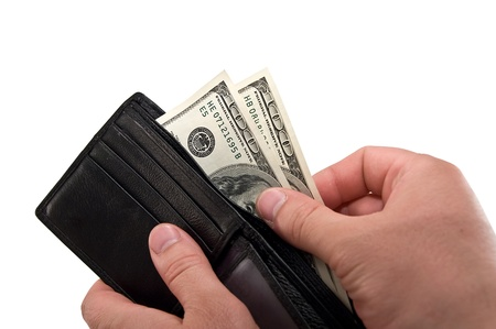 a black wallet with dollars in the hands photo