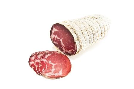 appetizing smoked ham on white
