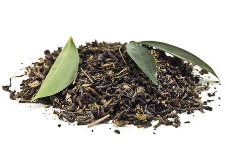 heap of green tea on white photo