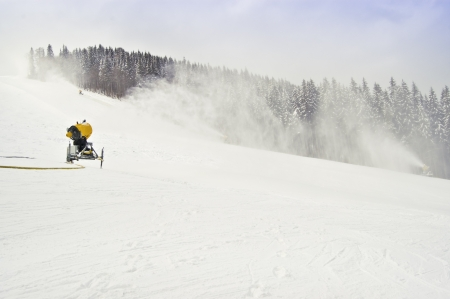 working snowmakers in the photo Stock Photo - 13658870