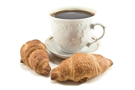 coffee and croissants on white photo