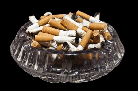 full ashtrey on black background photo