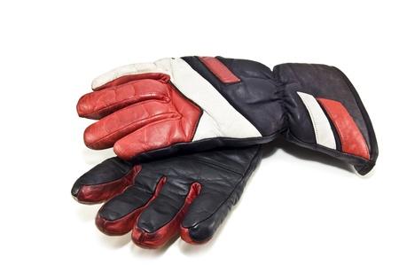 used ski gloves on white