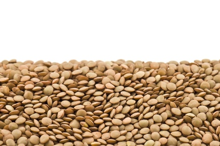 closeup of a pile of lentils on a white background  photo