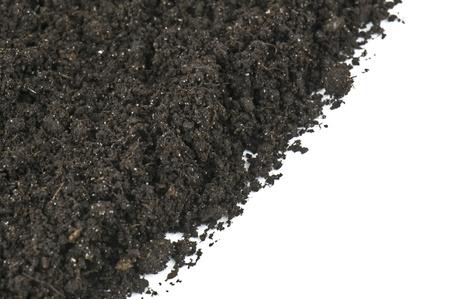 black soil as background on white