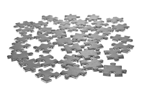 heap of puzzles on white